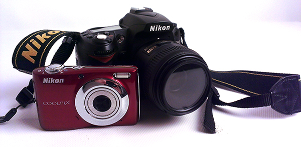 This is an example of a point and shoot camera (the red one) and a DSLR.