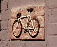 A brick bicycle on a building on Main Street in Jonesboro, Arkasnas. www.hannahandharley.com